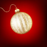 Twinkling gold bauble. EPS 10 Stock Images