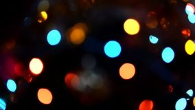 Twinkling lights, abstract blurred bokeh holiday garland stock video
