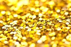 Twinkling lights bokeh light golden Christmas background Stock Photos