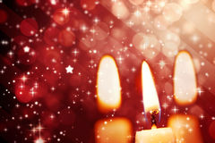 Twinkling stars against candle Stock Photo