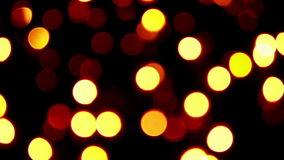 Twinkling strings with bokeh effect. Shimmering lights in the dark not in focus stock video footage