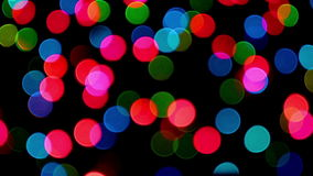 Twinkling strings with bokeh effect. Shimmering lights in the dark not in focus stock footage