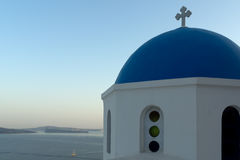 Twinlight view of Church with blue roof in town of Oia and panorama to Santorini island, Thira, Greece Stock Photos