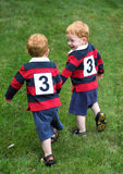 Twins. Twin baby boys holding hands outside Royalty Free Stock Photography