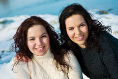 Twins. Girls twins near river in winter Royalty Free Stock Images