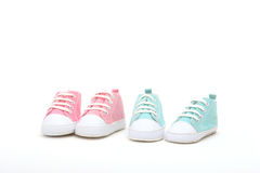 Twins. Shoes for a boy or a girl royalty free stock photos