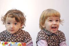 Twins. Two children with a gift Stock Image
