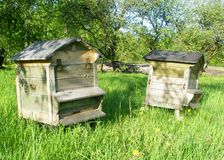 Twins. Two similar bee houses. In these houses live beehives royalty free stock images