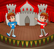 Twins are acting on the stage. royalty free stock images