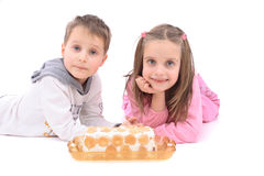 Twins And Sweet Cake Royalty Free Stock Photography