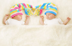 Twins Babies Sleep Hat, Newborn Kids Sleeping, Cute New Born. Twins Babies Sleep in Hat, Newborn Kids Sleeping, Cute New Born Girl and Boy Sleeping on White Stock Photo