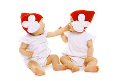Twins baby playing Stock Photos