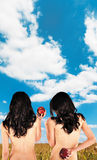 Twins backs apples clouds skyes Royalty Free Stock Image