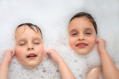 Twins in the bath Stock Photos