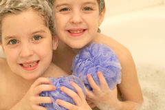 Twins in the bath. Tub royalty free stock images