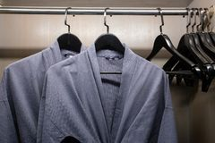 Twins bathrobe, security safe in wooden wardrobe in hotel stock image