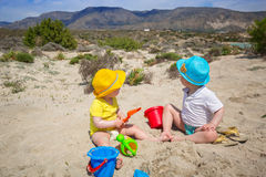 Twins on the beach holidays Royalty Free Stock Image