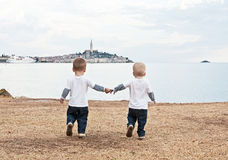 Twins on a beach Rovinj. Croatia. Stock Images