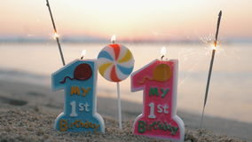 Twins birthday candles and sparklers on the beach stock video footage