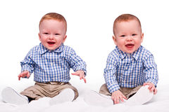 Twins boys sit isolated Royalty Free Stock Image