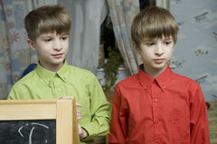 Twins brother at blackboard Stock Photos