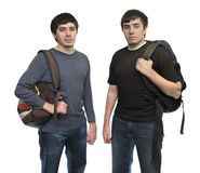 Twins brothers with rucksacks royalty free stock image