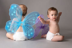 Twins with butterfly wings Royalty Free Stock Photography