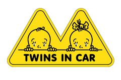 Twins in car sticker. Fases of baby boy and girl. Twins in car. Funny small faces of little baby boy and girl. Vector illustration with text or logo. Yellow stock illustration