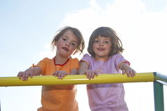Twins on climbing pole 01. Twins on a climbing pole - looking down to the photografer Royalty Free Stock Images