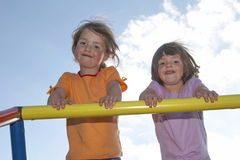 Twins on climbing pole 03. Twins on a climbing pole - looking down to the photografer Royalty Free Stock Image