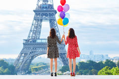 Twins with colorful balloons in Paris Royalty Free Stock Images