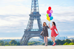 Twins with colorful balloons in Paris Stock Photos