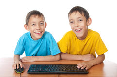 Twins with computer mouse and keyboard Royalty Free Stock Photo