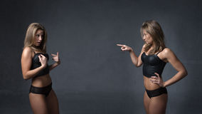 Twins discussion in dark background Stock Image