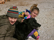 Twins and dog. Twins with their pet (black pariah dog Royalty Free Stock Photo