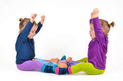Twins exercising Royalty Free Stock Photo