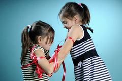 Twins exercising with red accessory Stock Photos