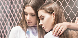 Twins female models posing outdoor. Stock Photo