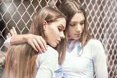 Twins female models posing outdoor. Royalty Free Stock Photos