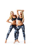 Twins fitness females royalty free stock photo