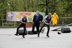 The Twins from France Clowns. And the participant dancing at Lag B'Omer celebration  in Earl Bales Park in May 18, 2014 in Toronto, Canada Stock Image