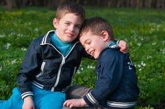 Twins frolic in a meadow Stock Photo