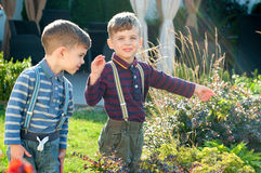Twins in the garden. Three year old identical in the garden Stock Photos