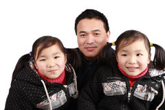 Twins girls and father royalty free stock images
