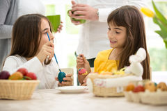 Twins girls painted Easter eggs Royalty Free Stock Photography