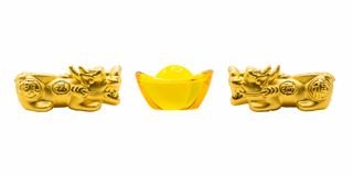 Twins gold Pixiu and yellow glass yuan bao ancient Chinese money royalty free stock images