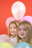 Twins happy birthday balloons. Shot of twins happy birthday balloons vertical royalty free stock photos