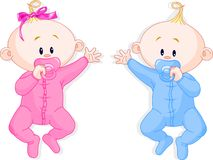 Twins hold the pacifiers Stock Image