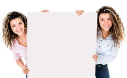 Twins holding a banner Stock Photos
