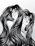Twins with interlocking hair Royalty Free Stock Photo